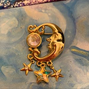 Kirks folly goldtone crescent pendant with stars